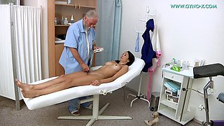 old guy plays with his patient in the gyno ward