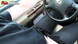Slutty amateur teen giving a handjob in the car