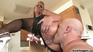 Very hot blonde dominates her man with a strap-on and toys!