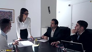 Hot brunette is having group sex at work instead of doing her job, and enjoying it
