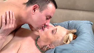 Mature blonde woman, Sila and a handsome, young guy, Rob are fucking and enjoying it