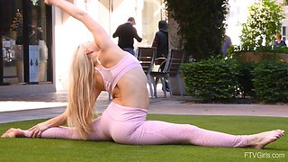 Flexible solo blonde model Nikki stretches out outdoors in thights