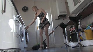 Leggy gal in the kitchen provides upskirt down blouse views