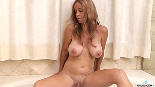 Mature amateur Totally Tabitha spreads her legs to masturbate