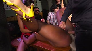 Man and his assistant have fun with black girl in local bar