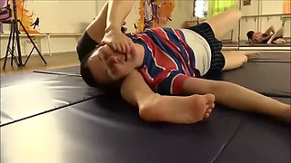 Small girl wrestling foot smother