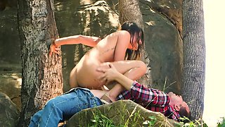 Picked up outdoors charming slender babe rides strong cock in the woods
