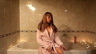 Sensuous girl with perfect tits masturbates in the bathtub