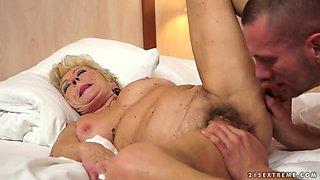 Blonde granny having sex with pretty stud