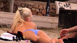 Attractive blonde exposes her big natural hooters outside