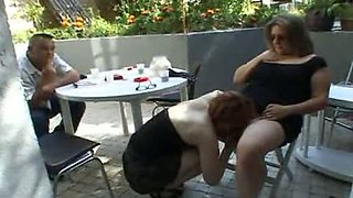 Family swingers party in the garden
