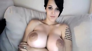hot girl with huge tits puts on an amazing dildo webcam show