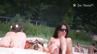 Nudist beach video of girls and guys lounging in the sun