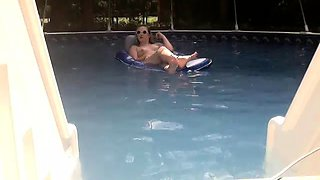 Enticing amateur blonde shows off her hot body in the pool