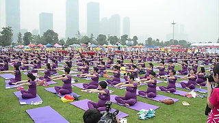 Pregnant Asian women doing yoga (non porn)