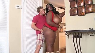 bbw ebony mature with huge boobs takes a junior white cock