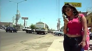 Sexy slutty woman at a bus stop