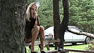 Depraved tanned nympho rubs her clit while pissing outdoors shamelessly