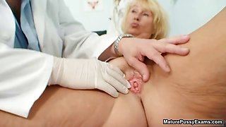 Horny doctor inspects a mature