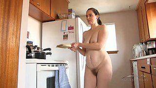 Naked hairy housewife shows off her tits and pussy