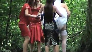 Bridesmaids help the bride pee