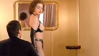 German femdom babe dominates a man in a suit