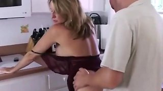 Stepson trying to force step mother in kitchen