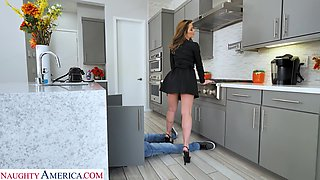 A MILF calls a young plumber and then fucks him in the kitchen